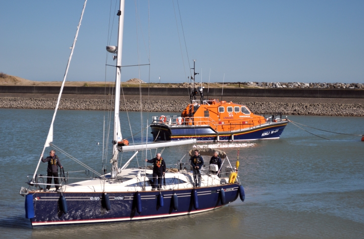lifeboat and sailboat in soverign harbour 2