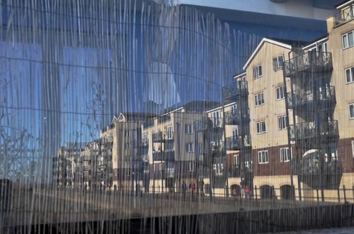 soverign harbour building reflection 4